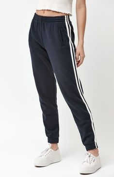 """Lounge around in style with the Side Stripe Jogger Pants by John Galt. These comfy joggers feature an elastic waistband, side pockets, side stripes, and elastic cuffs. 26"""" inseam Elastic waistband Elastic cuffs Side stripes Side pockets 82% cotton, 18% polyester Machine washable"""
