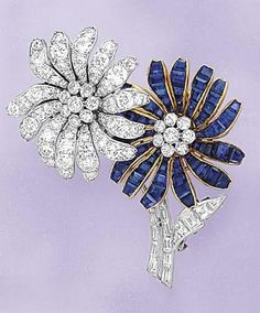 VAN CLEEF AND ARPELS (CO.) A Sapphire and Diamond Floral Pin, circa 1945  Designed as two flowers, one daisy with calibré-cut sapphire petals and the other with circular-cut diamond petals, each centering upon a circular-cut diamond cluster pistil extending baguette-cut diamond stems and a pavé-set diamond leaf, mounted in platinum and 18K yellow gold, length 5 cm. Signed 'Van Cleef & Arpels' and numbered.  With French assay marks
