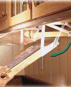 Swing-down cookbook rack. Customize it to fit an iPad/tablet as well!