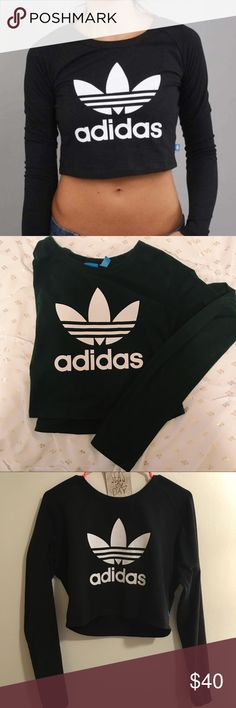 """RARE Adidas Crop Top Long sleeve Adidas Crop top with logo on front. Size large but fits a medium as well. I'm usually a medium but got a large so it wouldn't be as cropped as cover photo. I'm 5'4"""" & this shirt is barely cropped on me. This same shirt is going for $60-$72 on EBay- therefore my price is very discounted :) adidas Tops Tees - Long Sleeve"""