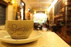 New Leaf Book Cafe branded cup.