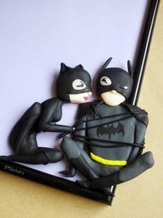 Catwoman and Batman made out of polymer clay on picture frame Idea…