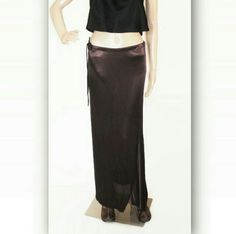 Ann Demeulemeester Brown maxi skirt 38/4 This is a vintage Ann Demeulemeester maxi skirt with an asymmetric hem a drawstring waist and a diagonal front diagonal zipper closure. Tres chic and very avant-garde! Mannequin is a size four and its not pend measurements: waist 32 inches. Hips 34 inches. Total average length 38 inches. More pictures available of course. Ann Demeulemeester Skirts Maxi
