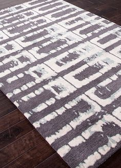Inspired by a modern interpretation of ethnic influences the Foundations collection skillfully combines primitive mark making with modern linear drawing techniques.Chayse uses mixed wool and art silk combinations to create texture and surface interest in these beautifully crafted tufted rugs.