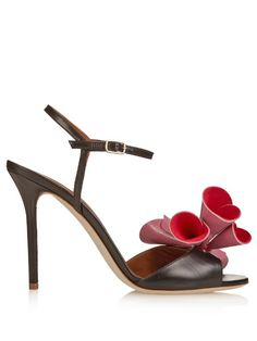 Malone Souliers crafts elegant heels with an artistic edge. These black leather Selma sandals are a great new-season pick, handmade with barely-there straps and elevated with a statement pink and red leather bow across the front. Wear them with a midi-length dress for a fresh take on event dressing | Available at #MATCHESFASHION
