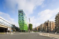 Completed in 2016 in Paris, France. Images by Luc Boegly . This development is in the arrondissement on the northern edge of Paris, within an urban environment characterised by the brick buildings of. Paris Hotels, Hotel Paris, Colour Architecture, Futuristic Architecture, Architecture Photo, Jean Nouvel, Facade Engineering, Paris Country, Human Environment