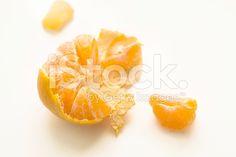 Mandarin fruit on white background, slices of mandarin and rind royalty-free stock photo