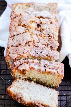 Deliciously moist banana bread with a cinnamon swirl in the middle and a crispy cinnamon sugar coating on the outside.