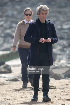The Doctor Peter Capaldi is spotted with Ingrid Oliver during filming for the ninth series of BBC show Doctor Who at Barry beach on May 18, 2015 in Barry, Wales. The beach was being used to film the aftermarth of a plane crash.
