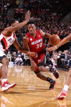 Norris Cole #30 of the Miami Heat drives to the basket against the Portland Trail Blazers