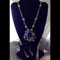 Iridescent Long Necklace Set This gorgeous glass set measures 32 inches long and includes matching earrings. Gold tone setting. (This closet does not trade or use PayPal ) Jewelry Necklaces