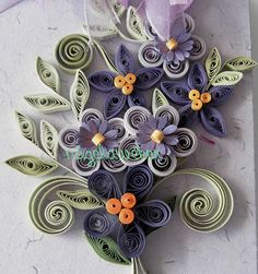 like the mix of quilling and die cut flowers and the pastel colors.