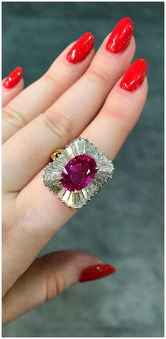 A magnificent vintage pink sapphire and diamond ballerina style ring by Oscar Heyman. From John Buechner, Inc.