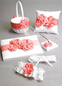 "Davids Bridal Exclusive Floral Desire collection features delicate satin flowers with layers of petals and beading. Gift Set inludes: Guest Book with Pen, Ring Pillow, Flower Girl Basket and Garter Set. Guest book has 16 pages and 243 lines for signatures. Measures 9 1/2"" x 6 1/2."" Ring bearer pillow measures 8"" square. Flower girl basket measures 11"" tall.Pearls, crystals, sequins, bugle beads and/or rhinestones that create patterns on a simple background for added sparkle.A smooth fabric…"