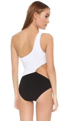 "Araks - Elmar One Piece Swimsuit | contrast colorblocking; side ""cutout;"" zigzag stitching trims edges; lined | 72% polyamide/28% spandex | $325.00"