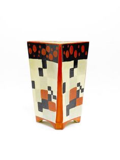 Clarice Cliff 'Red Café' a rare triangular section vase (shape 200), circa 1930 £8,000 - 12,000 US$ 13,000 - 19,000