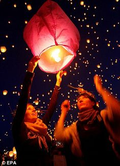 Thousands of Chinese lanterns are released during the Kupala Night in Poznan, Poland to celebrate the shortest night of the year