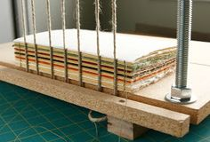 This past week, Daniel made a sewing frame for me. I've been doing all my cord bound books without a sewing frame. (I can just hear all the ...