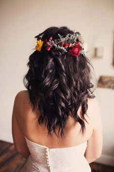 wedding hairstyles for medium hair half up on dark wavy hair decorated with bright red and yellow flowers ginny corbett photography
