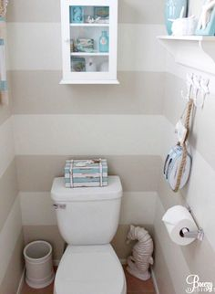 Beach Blue Powder Room - love the stripes and coastal theme happening  to give the toilet room a lift!