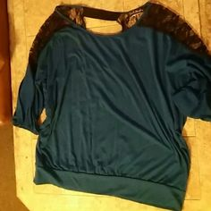Lace Shoulder Shirt Blue blouse that has sheer lace shoulders. Cinches at the bottom. Cut outs in the back. I cut part of the tag because you could see it through the sheer lace. Pictured above. Only worn once. French Atmosphere Tops Blouses