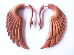 Swan wood carved earrings. Faux gauges for people who dont have stretched ears. You could get some like this! @Patty Acheson