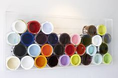Paint Bucket Art. You could buy those new empty cans at Home Depot and put whatever colors you wanted in them. Plexiglass surround for an installation look.
