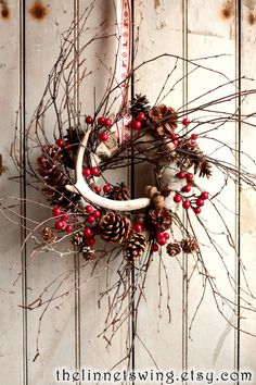 Solstice Antler Wreath Holiday Wreath by TheLinnetsWing on Etsy, $78.00