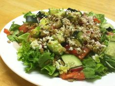 Yummy salad with: Lettuce Tomatoes  Cucumbers Radishes Avocados Cheese Roasted sunflower seeds Flax seed  & balsamic dressing on top