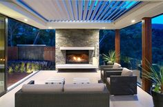 Outdoor wish list...Louvre roof & fireplace with stone front.