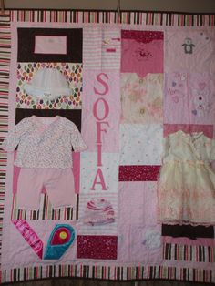 Crib sized quilt made from baby clothes and personalized with name