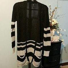 I just added this to my closet on Poshmark: Black and gray long cardigan size M. Price: $5 Size: M