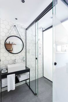 Looking for some bathroom inspiration for an upcoming bathroom renovation. How do you feel about hexagon tiles? Hexagon Tile Bathroom, Hexagon Tiles, White Bathroom, Modern Bathroom, Stone Bathroom, Geometric Tiles, Light Bathroom, Mirror Bathroom, Modern Shower