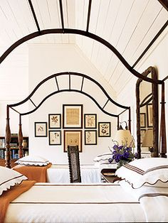 Never thought of using bare canopy frames. I like how it frames the pictures on the wall.