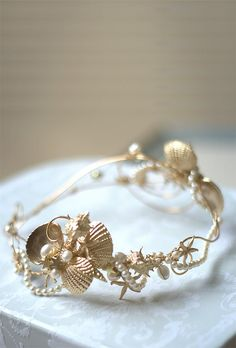 SIREN seashell headband Hand wired wedding headband featuring: - 14K gold plated seashells and starfishes - Swarovski crystal pearls -