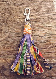 "This gorgeous keychain is made with colorful, vintage kantha fabric, wound into a fringed tassel. Attach it to your keys, or we love it clipped to your favorite wallet or purse! - Approx. length 6"" -"