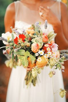 Unique + fresh, organic fall and autumn wedding bouquet idea - orange ranunculuses, chamomile, hops, wild berries, and vegetables, including tomatoes and radishes {Gideon Photography}