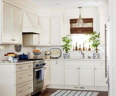 white kitchen blue accents   love how simple this kitchen is but it's still so pretty. I've been ...