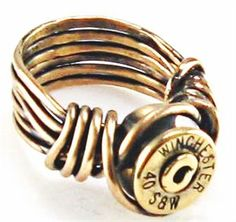 Unique, wire-wrapped, bullet shell casing ring - Sterling silver wire with pure brass recycled bullet shell casing. Bullet shell may vary in size and brand name. Bullet Shell Jewelry, Shotgun Shell Jewelry, Bullet Casing Jewelry, Ammo Jewelry, Bullet Ring, Wire Jewelry, Jewelry Rings, Jewelry Box, Jewelry Accessories