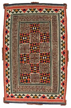 Ralli quilt, probably made in Cholistan, Punjab, Pakistan, circa 1950-1960,82 x 50.5 in. This ralli combines the solid feel of nine-patch geometric blocks with appliqué blocks and wide borders. The burgundy and deep gold colors, as well as embellishments on the edge (particularly with metal pieces that jingle together), are popular. This is a dowry quilt given to a Cholistani woman who was married to a Sindh man and moved to Sindh.