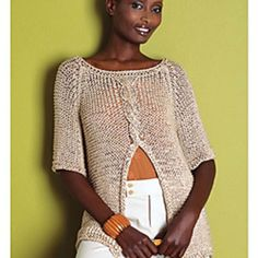 """Pattern description from Vogue Knitting, Spring/Summer 2008: """"The exceptional drape of this kimono-inspired raglan top by Yoko Hatta (Kazekobo) is produced on large needles with ribbony 'Bamboo Tape' from Rowan/Westminster Fibers. The flyaway effect occurs naturally with the front pieces are connected by a cable."""""""