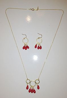 Coral earrings $46 Coral necklace $56 by Raised By Wolves NYC