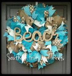 Who is ready for Summer??? I know I am. This wreath is perfect for your house, beach house or boat. This wreath is made on a 24 inch work form so it is approximately 25 to 26 inches around and extends approximately 7 to 9 inches from the door or wall. Woven around the wreath form is a turquoise blue deco mesh with metallic foil and natural deco mesh with jute strips. Tied to each tie is 2.5 inch wired white burlap ribbon, 2.5 wired natural ribbon with white dots and 2.5 inch wired turquoise…