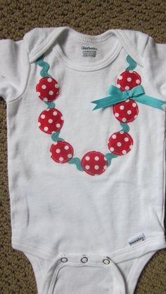 necklace and ric rac applique onesie