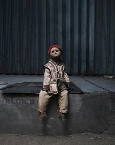 creepy photos of monkeys wearing doll masks