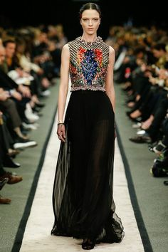 Long black chiffon dress decorated with shinning fragments of broken jewel. GORGEOUS. #TOPSHOPPROMQUEEN