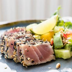 Seared Tuna Sashimi with Asian flavors served with a spicy Avocado Salsa | cuisinejosephine.com