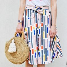 With multiple textures and prints, this full skirt is reminiscent of Audrey Hepburn's iconic style. Simply pair with a button-down and ballet flats to complete the look. Photo by @hellokatiegirlblog