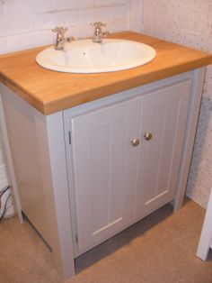 Pavillion grey vanity unit with a solid oak top and brushed chrome knobs. Our vanity units can be made to any size to fit into your bathroom perfectly. All our furniture is made in our Yorkshire based workshop and we then deliver all over the country. Our furniture is built to last as it is made from natural pine or solid oak. We don't use MDF! Visit www.aspennfurniture.co.uk to view more of our range or contact us on 01937 843386 / ianaspenn@btinternet.com