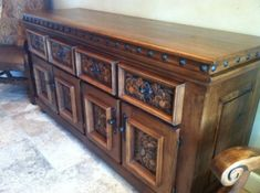 Having multiple drawers and cabinet space, this solid alder wood buffet would be perfect for any dining room. Behind the custom hand tooled leather (optional) lies plenty of storage space for all of your dinnerware. This piece features a prairie flower design on the doors. Custom sizes available, call for more information. Allow 8-10 weeks for delivery.